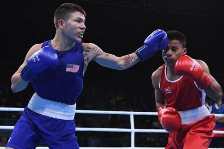 Узбек Хасанбой Дусматов одержал победу золото ввесовой категории до49кг
